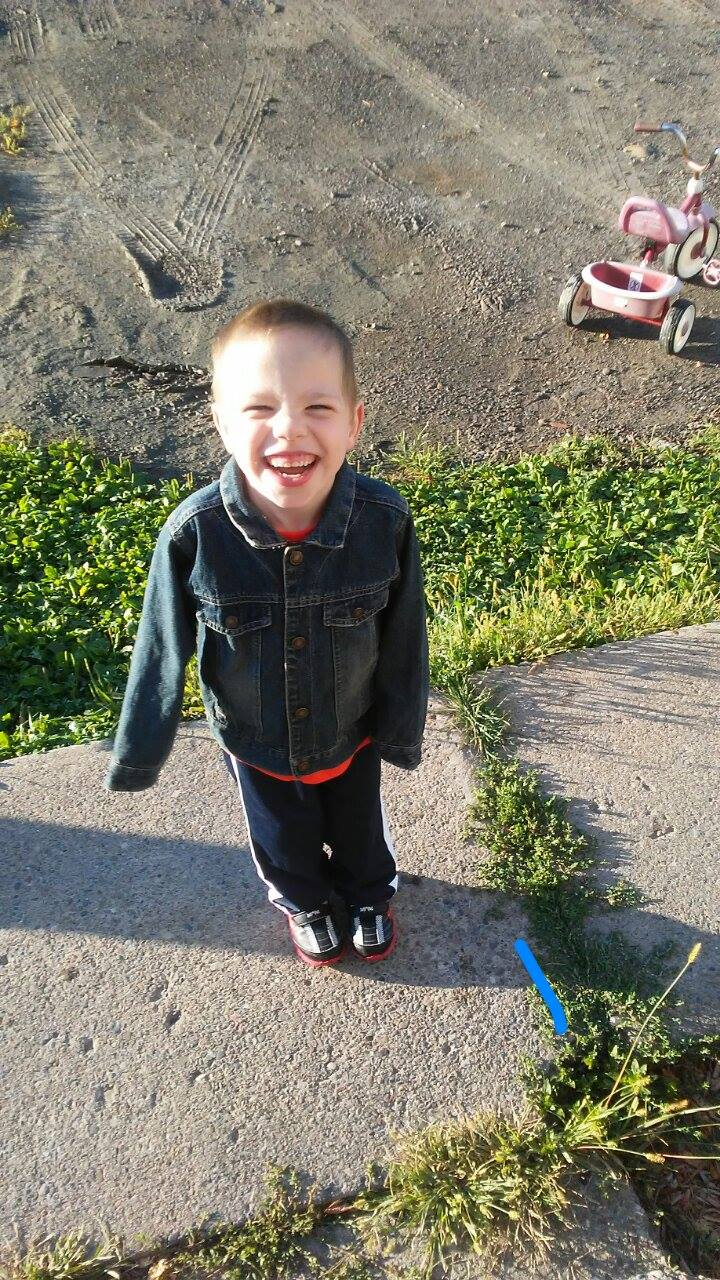 Roberson boy smiling standing outdoors
