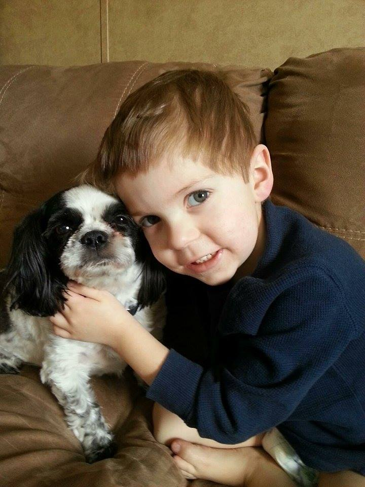 Purdy family boy with his black and white dog